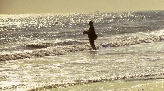 Man surf fishing at Breezy Point