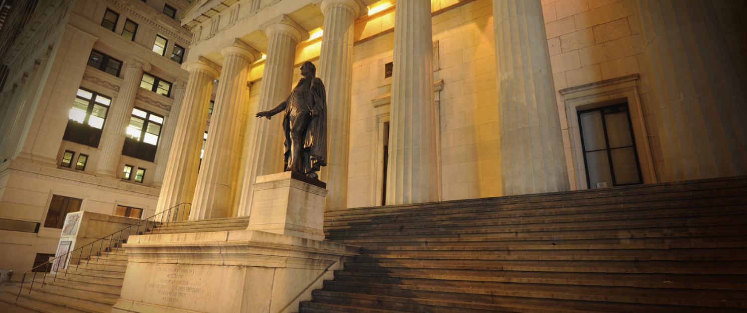 George Washington statue and steps of Federal Hall at night