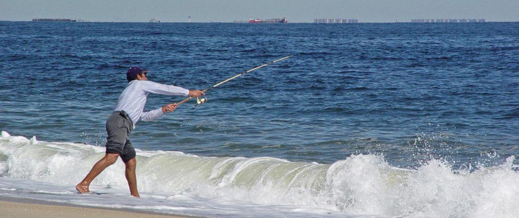 Fisherman casting off surfside
