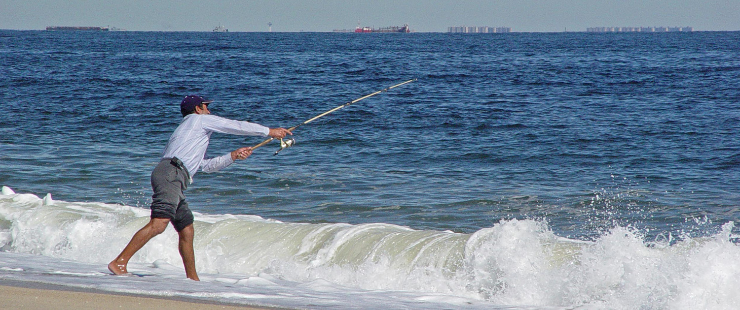 Fisherman casting off surfside