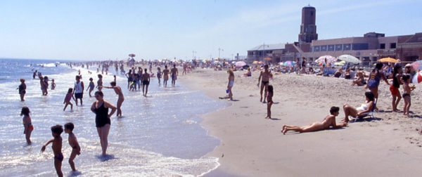 Beachgoers enjoying summer at Riis Landing beach