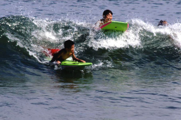 Kids body boarding at Sandy Hook